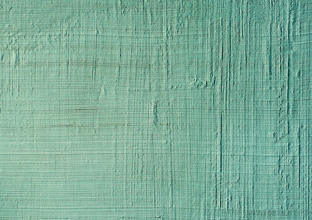 Blue or green textured putty close-up. vintage or grunge surface texture venetian stucco in the pattern of the wall. Premium Photo