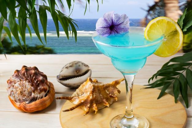 Blue hawaiian cocktail on the tropical sea Premium Photo