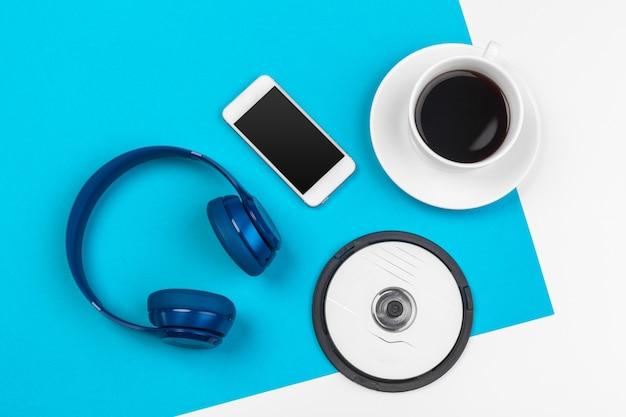 Blue headphones on blue and white color Premium Photo