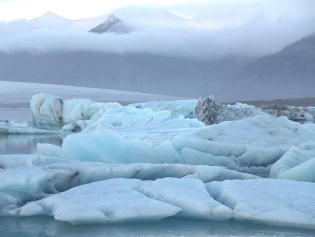 Blue icebergs floating in jokulsarlon glacier lagoon, south iceland Premium Photo