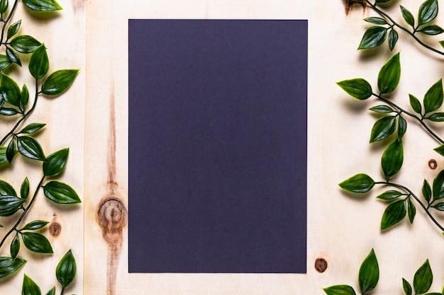 Blue invitation on wooden background Free Photo