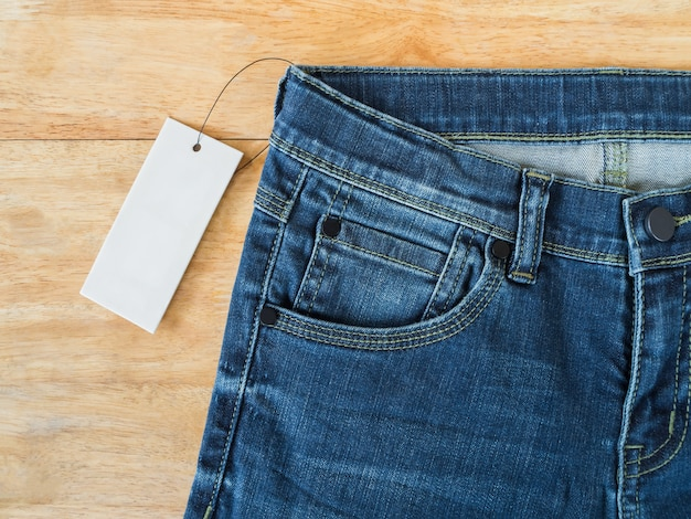 Blue jeans with white blank price tag Premium Photo