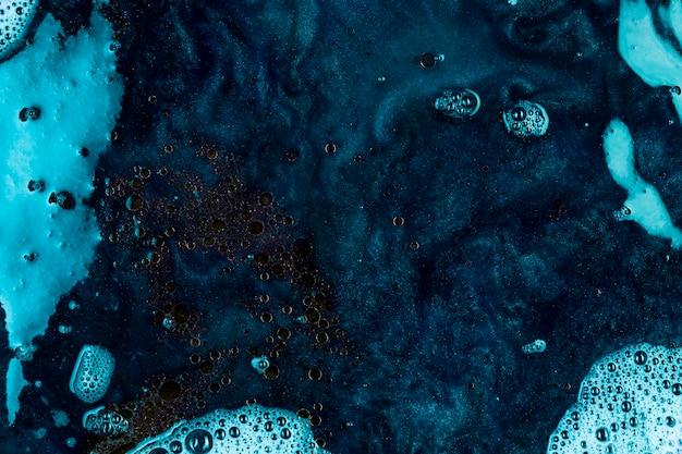 Blue liquid with black blobs Free Photo