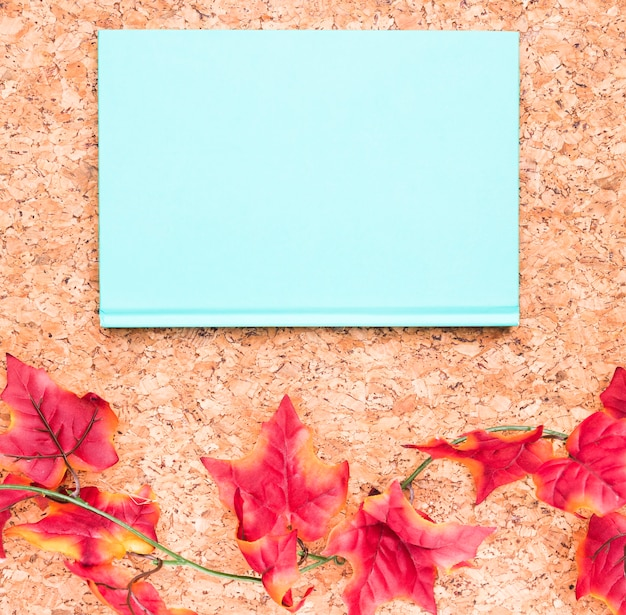 Blue notebook and maple leaves Free Photo