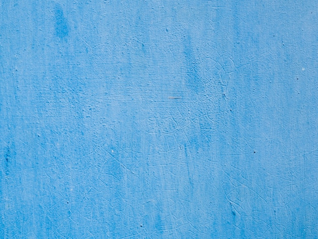 Blue painted textured wall background Free Photo