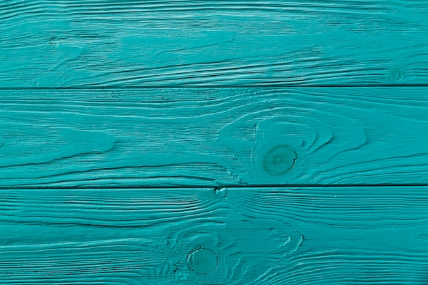 Blue painted wooden surface with knots Premium Photo