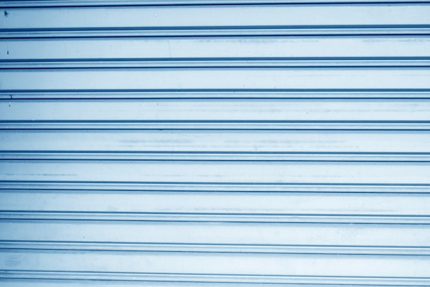Blue panel steel wall background Premium Photo