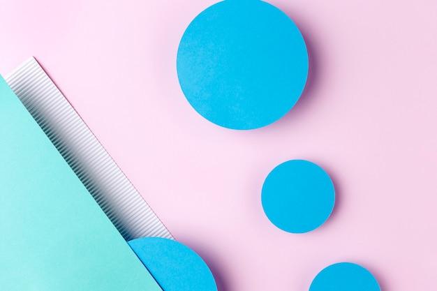 ピンクの背景に青い紙円 無料写真