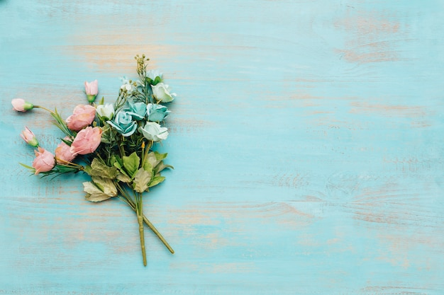 Blue and pink flowers with vintage wooden background. Free Photo