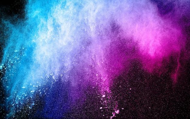 Blue pink powder explosion on black background. Premium Photo
