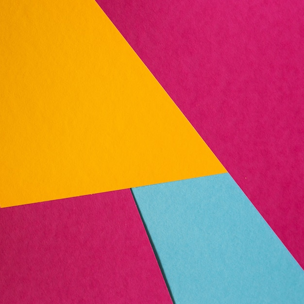 Blue, pink, yellow pastel color paper geometric flat lay background. Free Photo