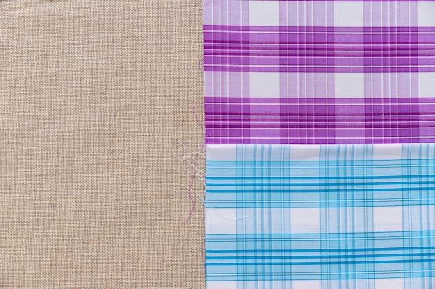 Blue and purple pattern fabric on plain sack cloth Free Photo