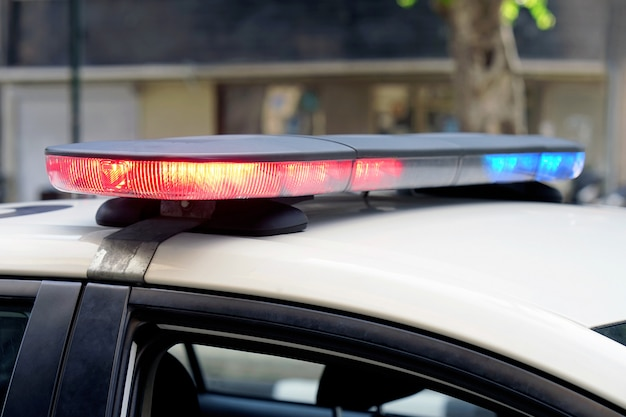 Blue and red lights on top of police car Premium Photo