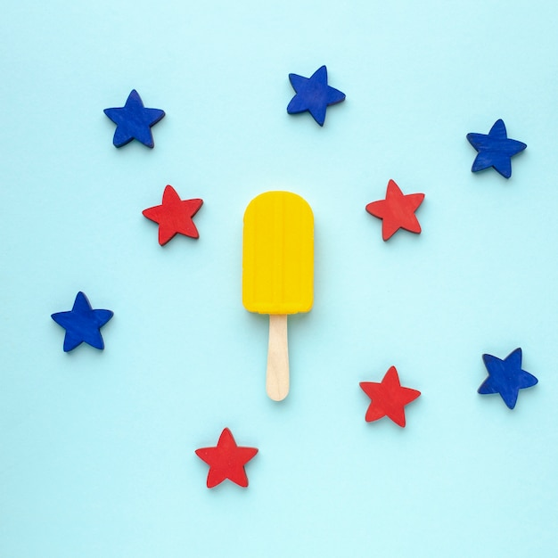 Blue and red stars beside ice cream on stick Free Photo