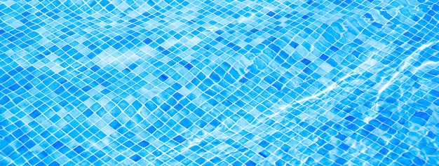 Blue ripped water in swimming pool summer vacation banner Premium Photo