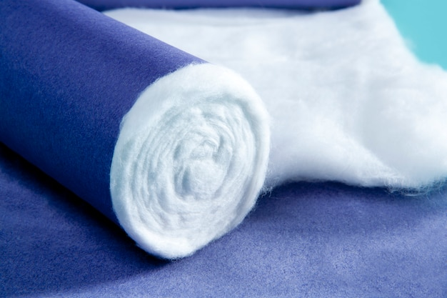 Blue rolled medical cotton pharmaceutical background Premium Photo