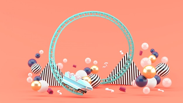 A blue roller coaster among colorful balls on pink. 3d rendering. Premium Photo