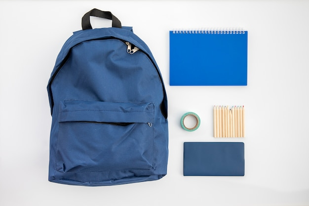 Blue school accessories on table Free Photo