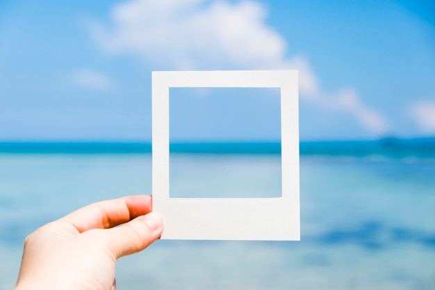 Blue sea in instant photo frame Free Photo