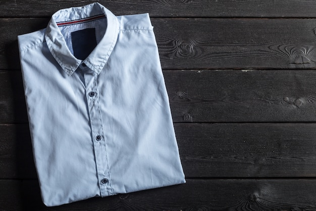 Blue shirt on a black wooden Premium Photo