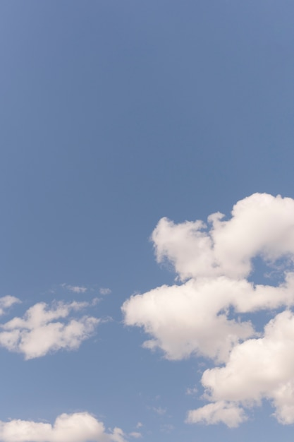 Blue sky with white drifting clouds Free Photo