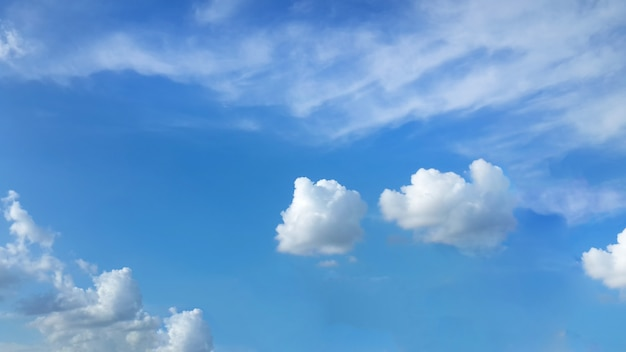 Blue sky with white fluffy clouds Free Photo