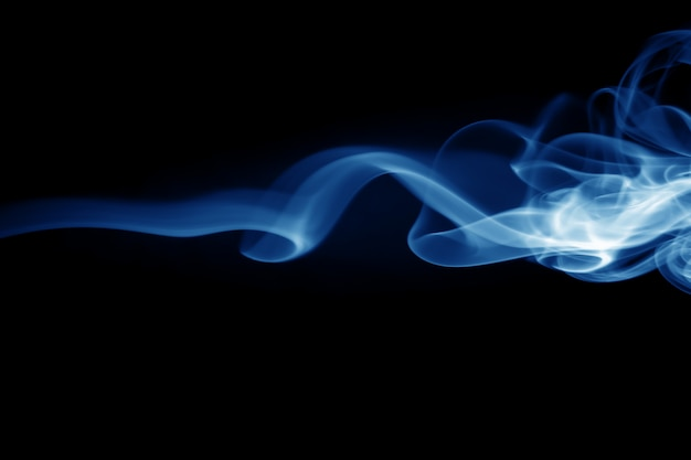 Blue smoke abstract on black background, darkness concept Premium Photo