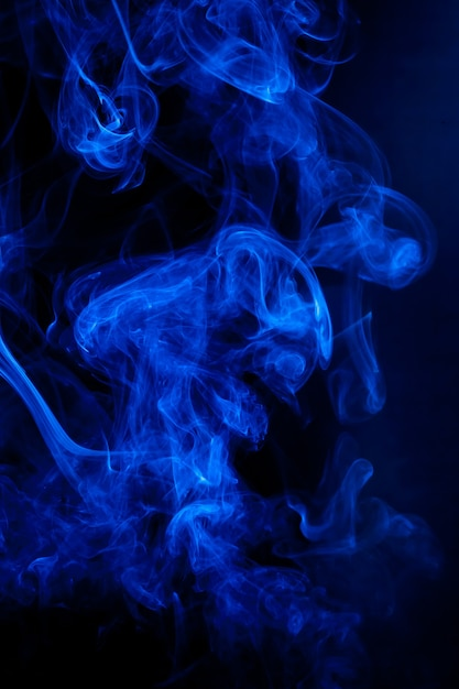 Blue smoke motion on black background. Premium Photo