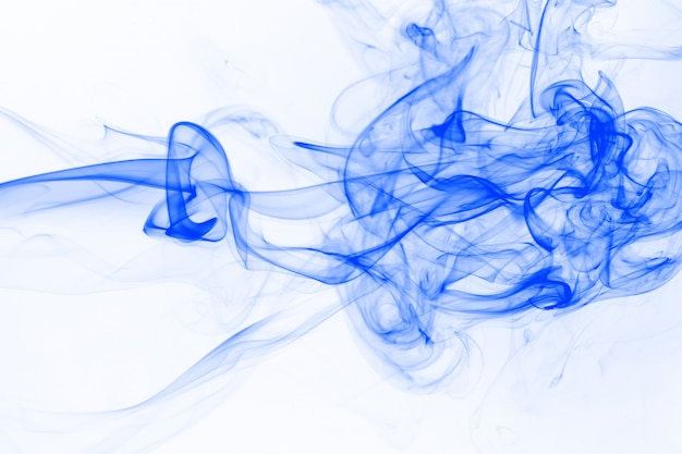 Blue smoke movement on white background, ink water color Premium Photo