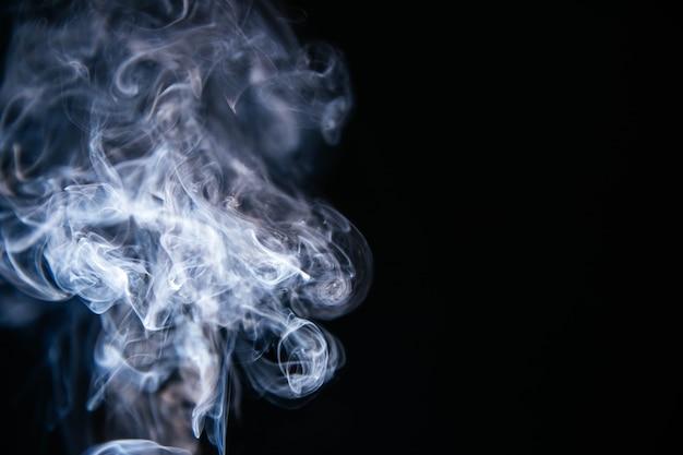 Blue smoke waves on black background Free Photo