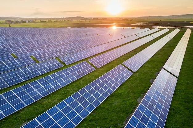 Blue solar photo voltaic panels system producing renewable clean energy on rural landscape Premium Photo