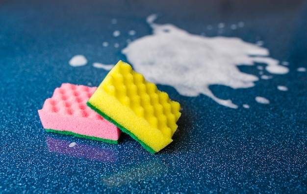 Blue sponge for cleaning with copy space Premium Photo