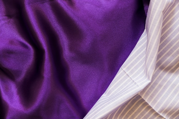 Blue stripes pattern and silky purple textile Free Photo