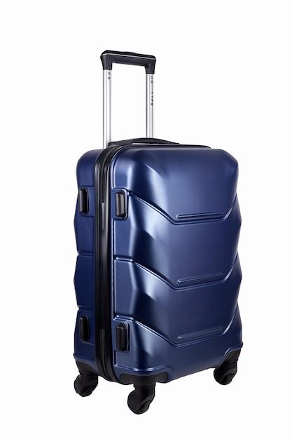 Синий чемодан на белом Premium Фотографии
