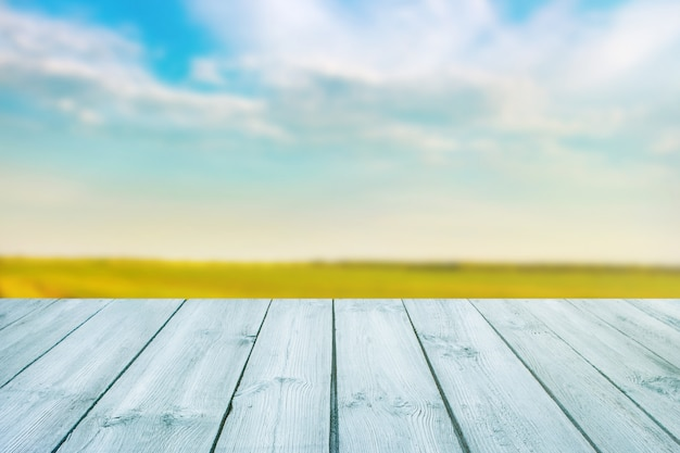 Blue table on blurred background of landscape with blue sky Premium Photo