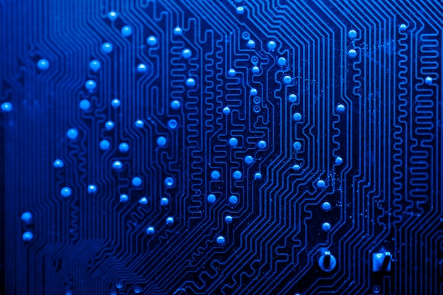 Blue themed circuit board close-up Free Photo
