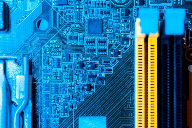 Blue themed motherboard with slots close-up Free Photo