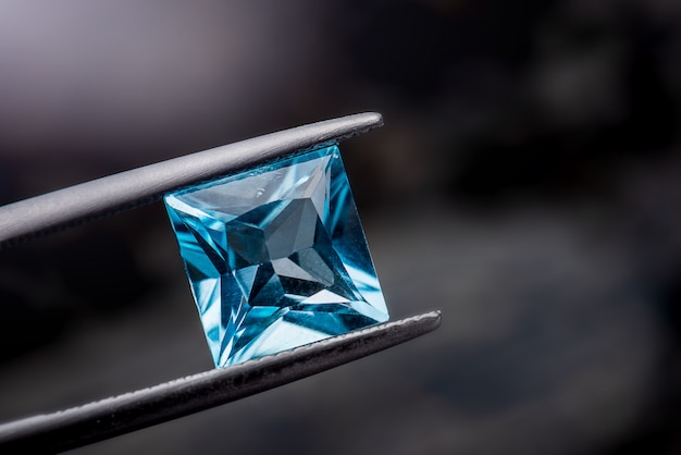 Blue topaz gemstone jewelry. Premium Photo
