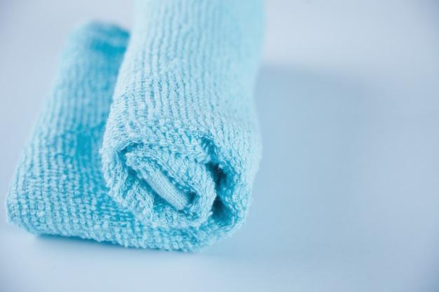 Blue towel spa cloth beach towel on blue background. Premium Photo