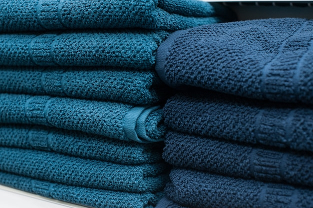 Blue towels on the shelf in the closet Premium Photo