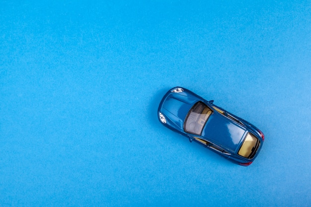 Blue toy car on blue colored Premium Photo