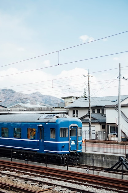 Blue train and sky in railway of japan Free Photo