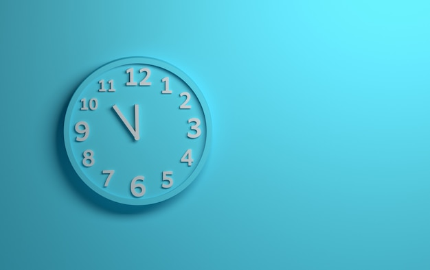 Blue wall clock with white numbers on background of blue Premium Photo