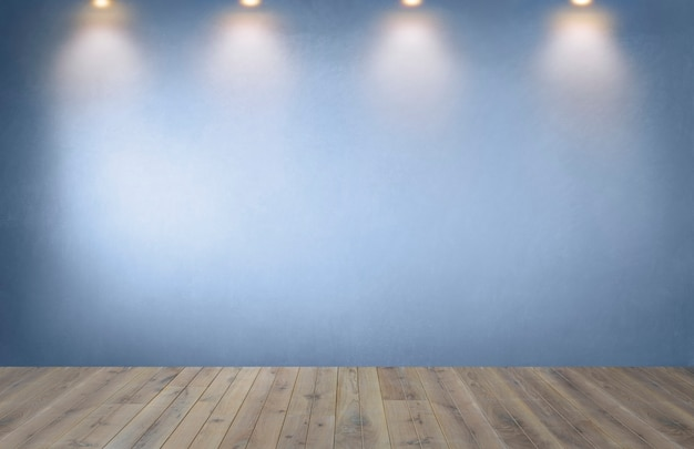 Blue wall with a row of spotlights in an empty room Free Photo