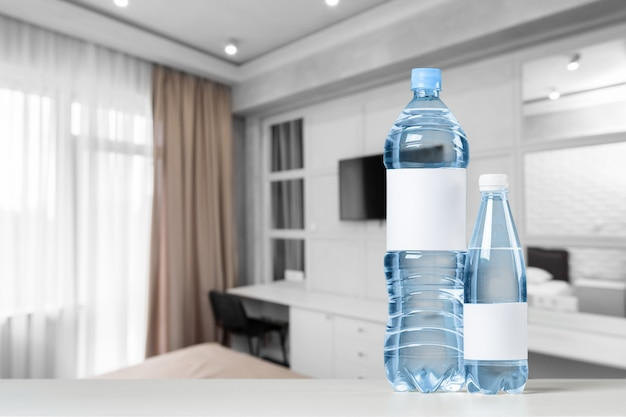 Blue water bottle on a table front view Premium Photo