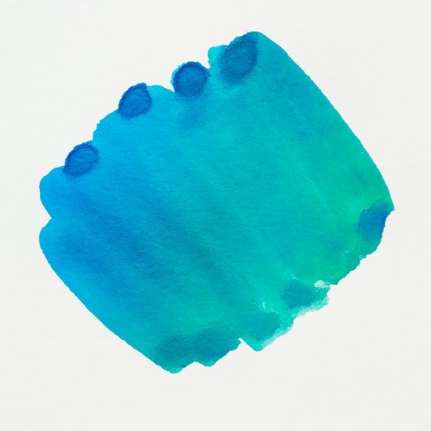 白い背景に青い水彩画汚れデザイン 無料写真