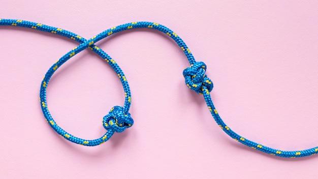 青と黄色の点ロープの結び目 無料写真