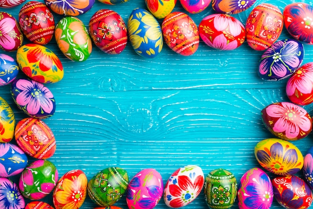 Blue wooden surface with easter eggs frame Free Photo