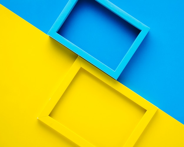 Blue and yellow frames on bicolor background Free Photo