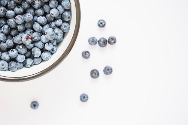 Blueberries bowl on white background Free Photo